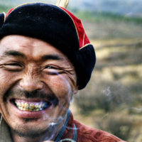 Mongolian man smoking.